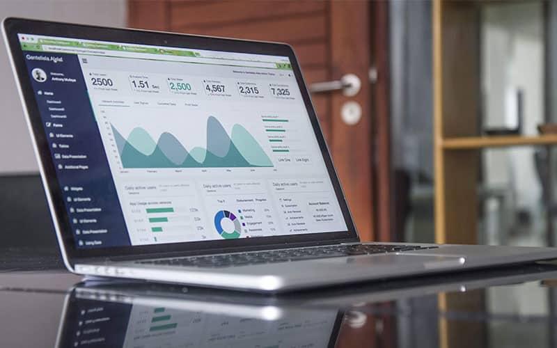 Analysing digital marketing campaign progress on laptop